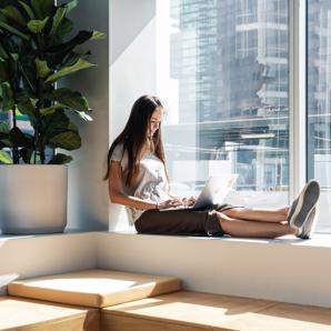 Employee working by window